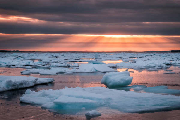 Photo of melting ice in ocean. Picture credit: Erik Mclean, Unsplash